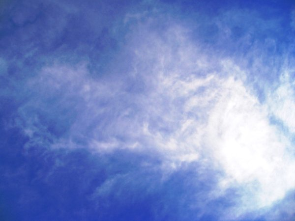 Spring Clouds: Interesting cloud shapes in a bright blue sky.