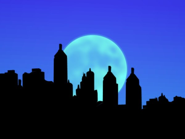 City Sillhouettes With Moon 3: Sillhouettes of buildings against a large moon.