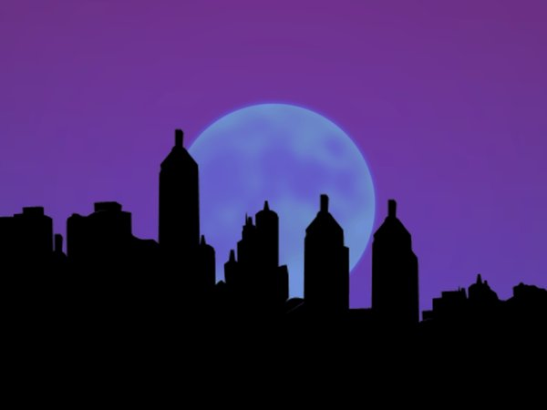 City Silhouettes With Moon: Sillhouettes of buildings against a large moon.