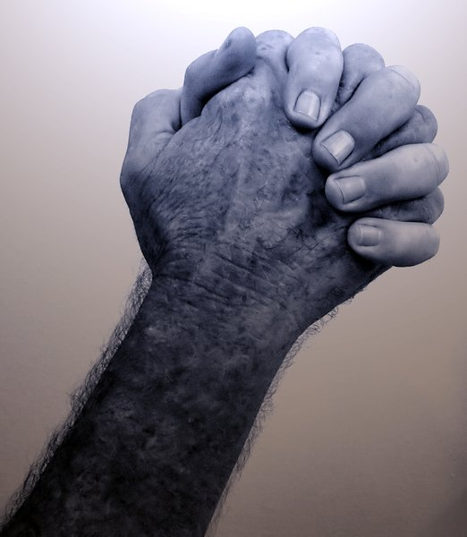 Praying Hands 2: A man's hands together in prayer.