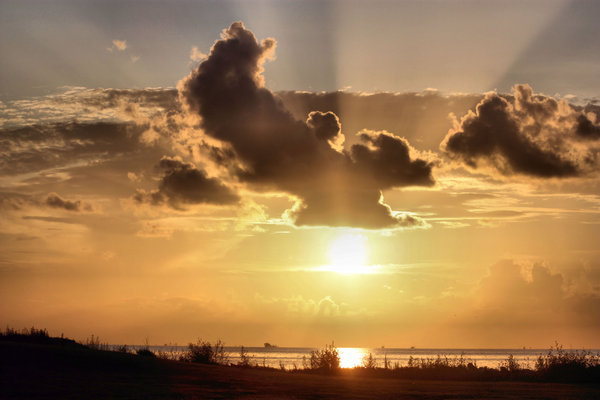 Cloudy Sunrise: Sunrise over the Texas Gulf Coast.
