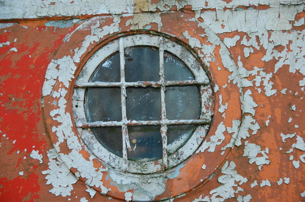 Winter Project detail 1: A window on an old boat on the River Waveney, Suffolk, England.