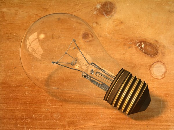Lightbulb: Detailed lightbulb on a wooden background