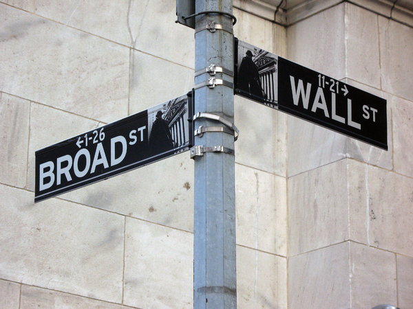 Wall Street: Street sign at Wall Street and Broad Street in New York City.