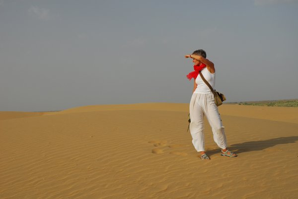 Lost in desert: lady looking the horizon in Tar desert, Rajastan, india