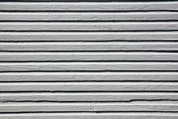 Clapboard: Clapboard siding on an old house.