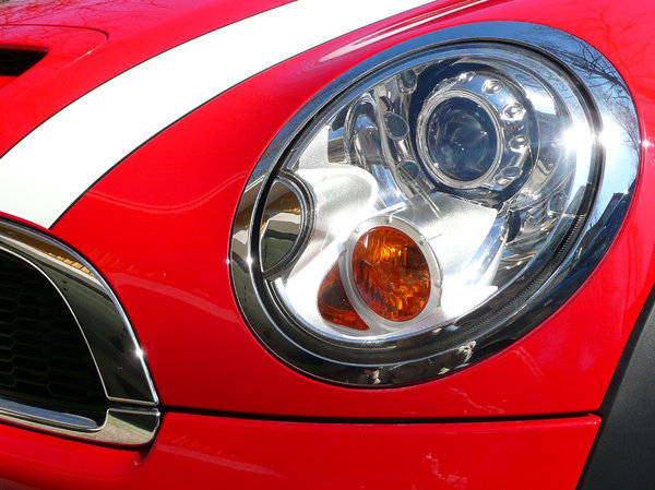 Headlight: Closeup of a red cars headlight