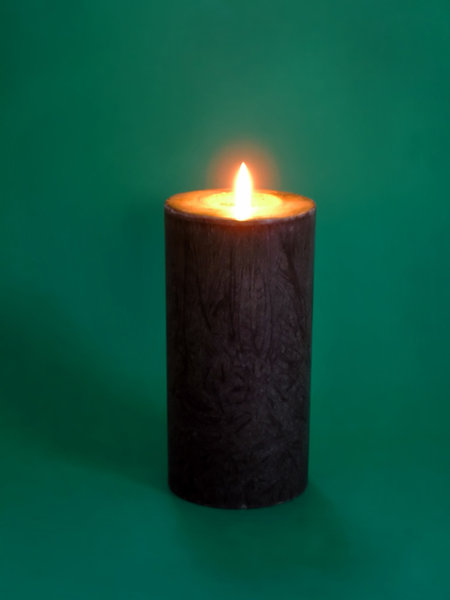 Candle: Lighting candle on the green background