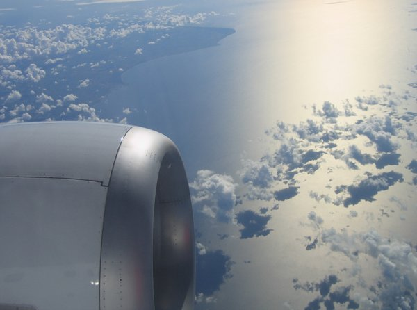 clouds and shadows: A scenery of clouds and their shadows on a sea - seen from an airplane window in flight.