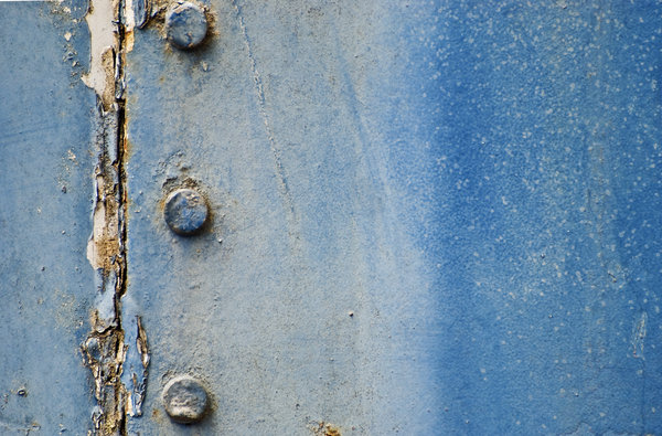 Blue peeled texture with bolts: blue industrial texture