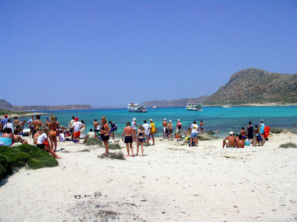 Ferries by the beach: Photos from Crete, Greece.The Blue Laguna Beach.Ferryboats were waiting for passengers.