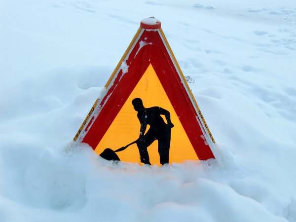 A sign in the snow: A traffic sign in the snow