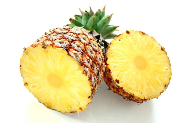 Pineapple: Fresh pineapple sliced in half