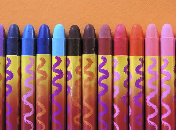 Crayons: Crayons against orange background