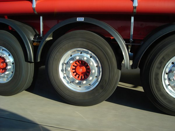 Lets go!: Big wheels speeding on motorway