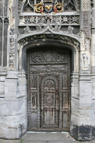 Ancient door: An old wooden door in the perimeter wall of Canterbury Cathedral, Kent, England.