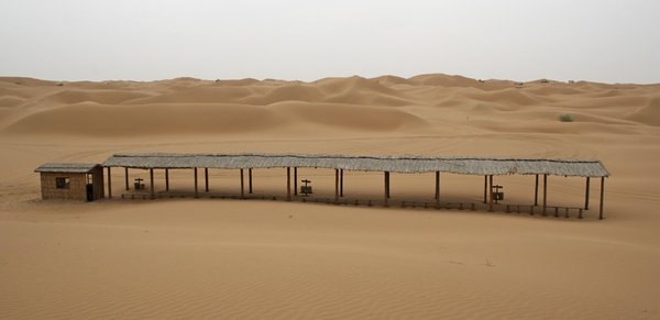 Desert car-park: A parking area for quad bikes in the Tengger Desert, China.