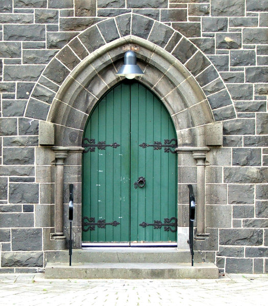 closed doors: closed green doors of historic old church building