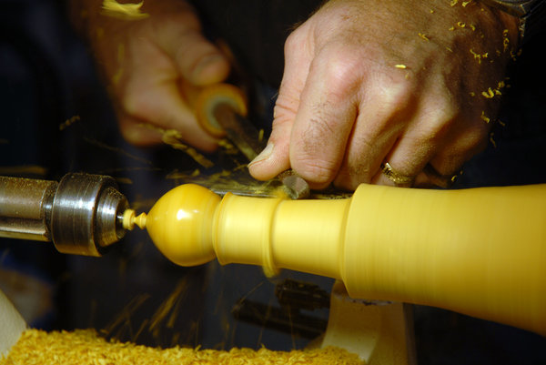 Woodworker: A woodworker's hands.