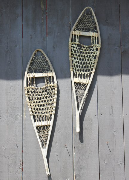 snow shoes: snow shoes on a side of a barn in New England