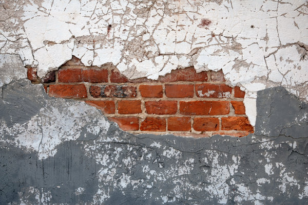 Brick Wall: A brick wall covered with plaster.