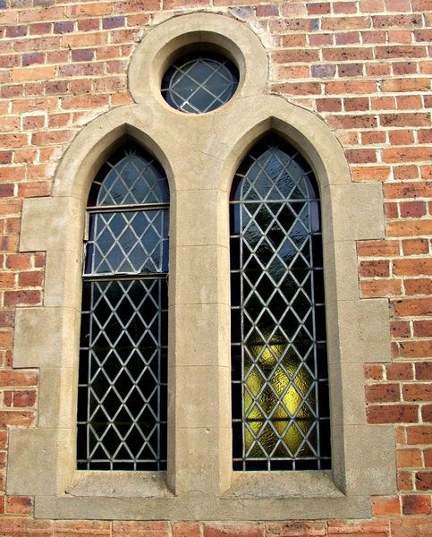 framed window: arched artglass church windows