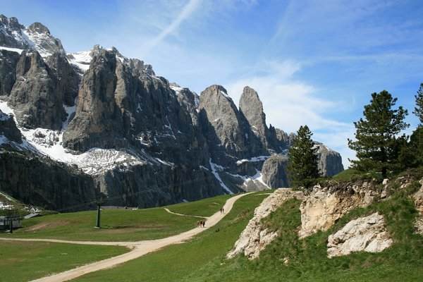 Mountain stroll 2: Walkers enjoying strolling high in the Dolomites, Italy.