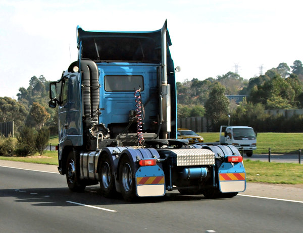 trucking: blue semi-trailer truck on Australian highway