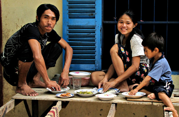 Cambodian lunch: a family eatring lunch at home in Cambodia