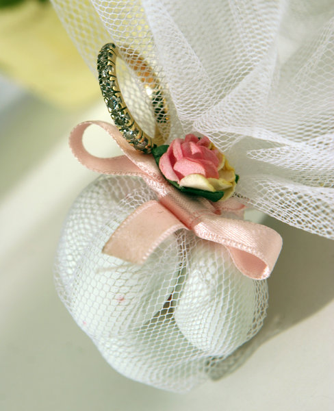 wedding abstract: wedding ring and rose on the lace