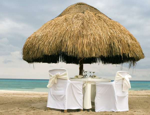 romantic summer beach: dinner tables on the sunny beach