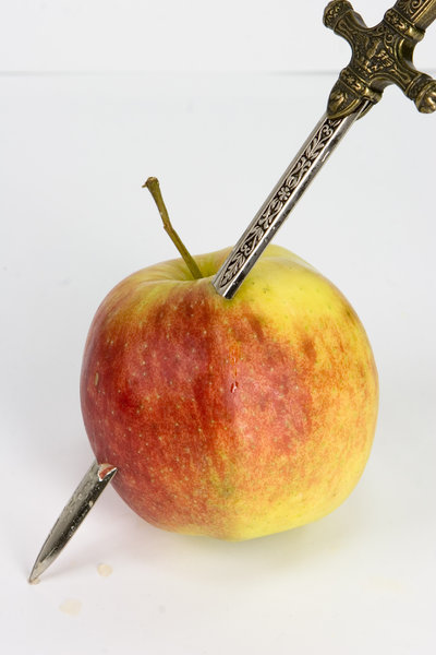apple with sword: fresh apple