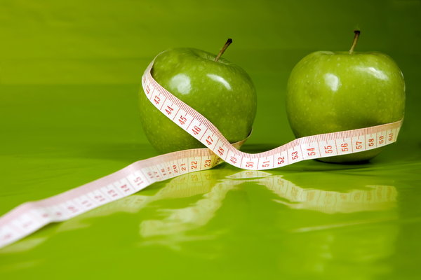 perfect  figure: two apples with centimeter,greenbackground