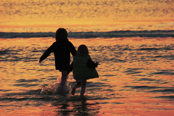 happiness: kids in the sea