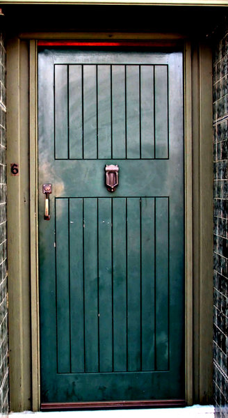 green corner door: green wooden door of house on street corner
