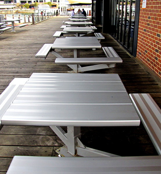 waiting for a meal: aluminium alfresco dining settings at marina