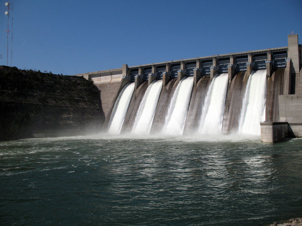 Dam: Water flowing over a dam.