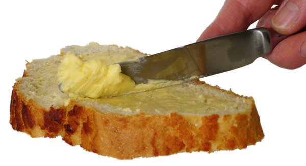 Spreading: Spreading butter on bread