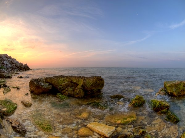 Coast, cliff and sea - HDR: rocky coastline in sunraise. The picture is HDR