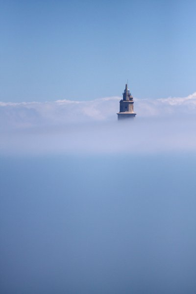 The fog & the Tower of Hércul: Ancient Roman lighthouse. The structure is 55 metres (180 ft) tall and overlooks the North Atlantic coast of Spain. The structure, almost 1900 years old and rehabilitated in 1791, is the oldest Roman lighthouse still used as a lighthouse. UNESCO World