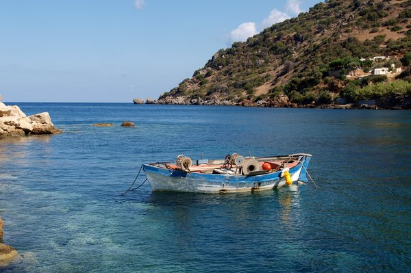 Greek fishing boat: Small typical greek fishing boat in a natural harbur.