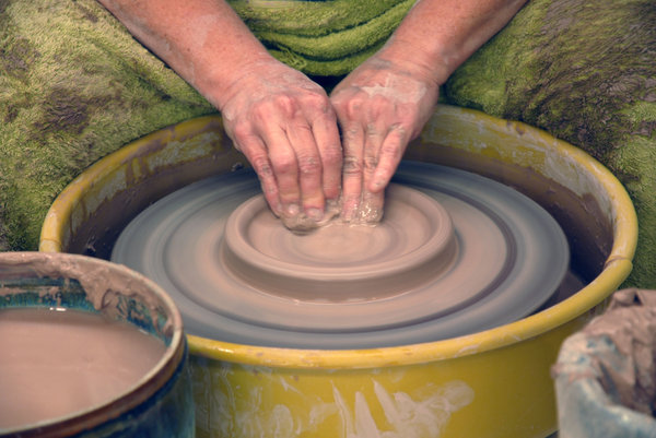 Potter: A potter throwing a pot.