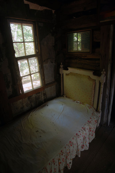 Bed: A bed in an old house.