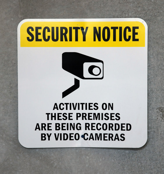 Security: Security camera warning sign.