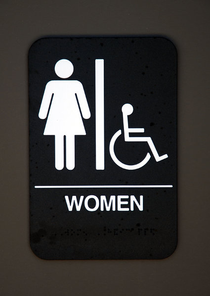 Women: The sign on a women's restroom