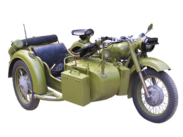 Motorcycle with sidecar: An old motorcycle from II world war. Isolated. Picture taken at Konewka, Poland.