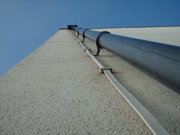 Drain pipe in perspective: A drain pipe/down pipe on a tall building