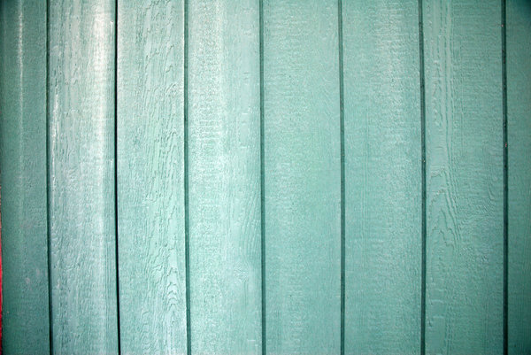 Blue Paint: Blue paint on a wood wall.