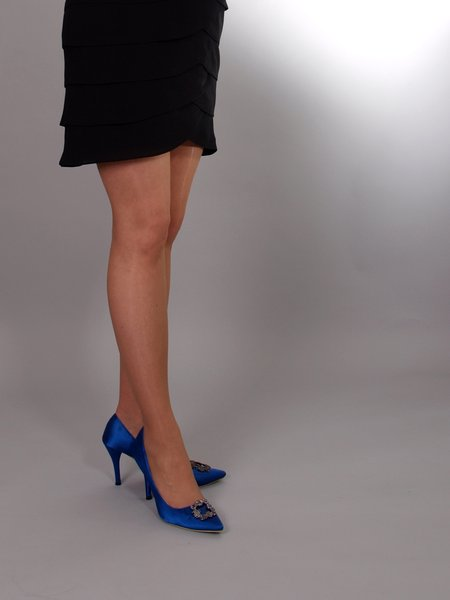 Woman with high heels: Woman standing in a dress and with high heels.