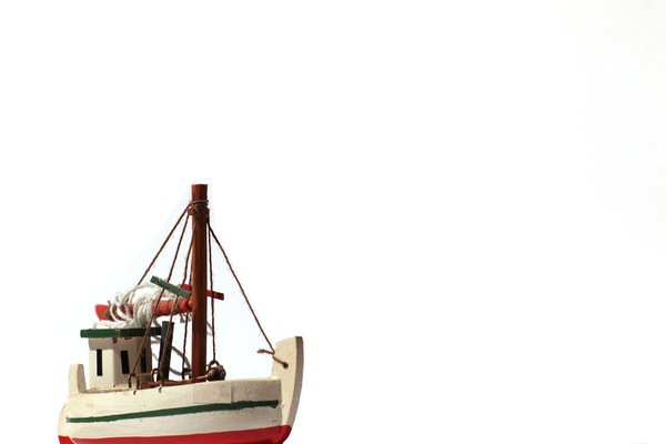 Fishing boat - model: A small model of a fishing boat with white background